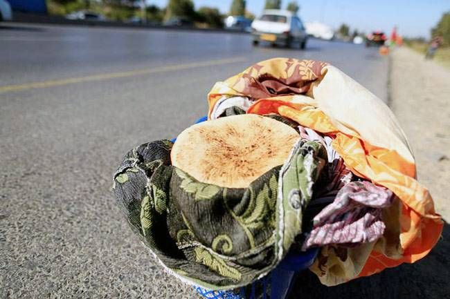 A basket with traditional Ramazan bread for customers is seen during the Muslim holy month of Ramazan on the edges of a highway on the outskirts of Algiers, Algeria.