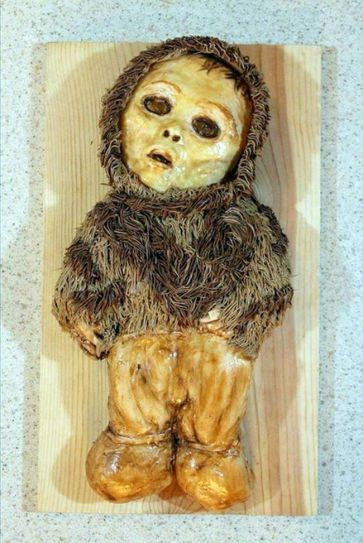 The Baby Mummy cake shows a creepy baby that can easily remind you of the horror movie, Grudge.