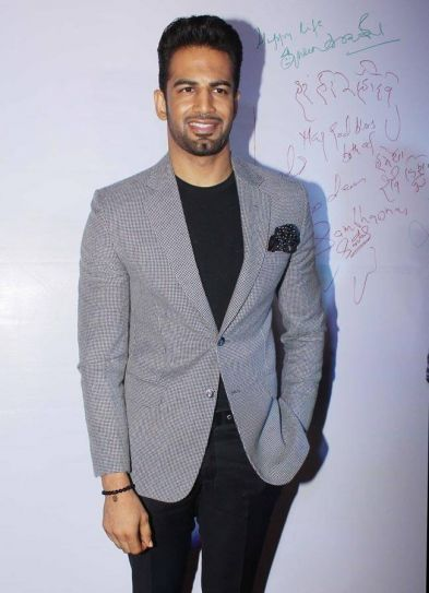 Upen Patel looks dapper in this grey and black suit.