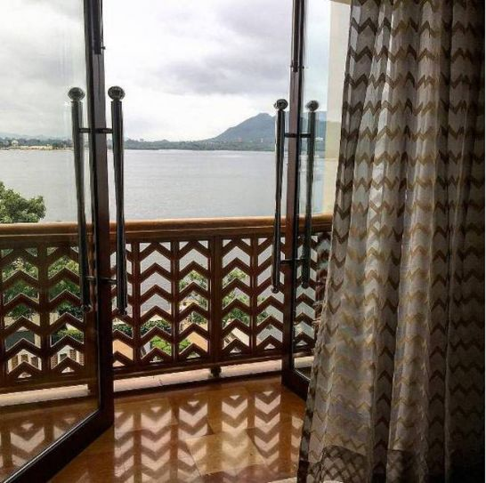 Look at the perfect balcony view from the couple's hotel--Lake Pichola.