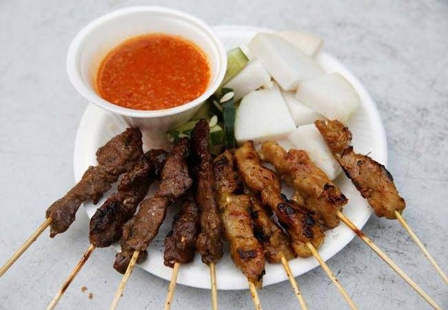 A plate of $5 satay (skewered meat) is served at Asli Satay Club at Lau Pa Sat food centre in Singapore.