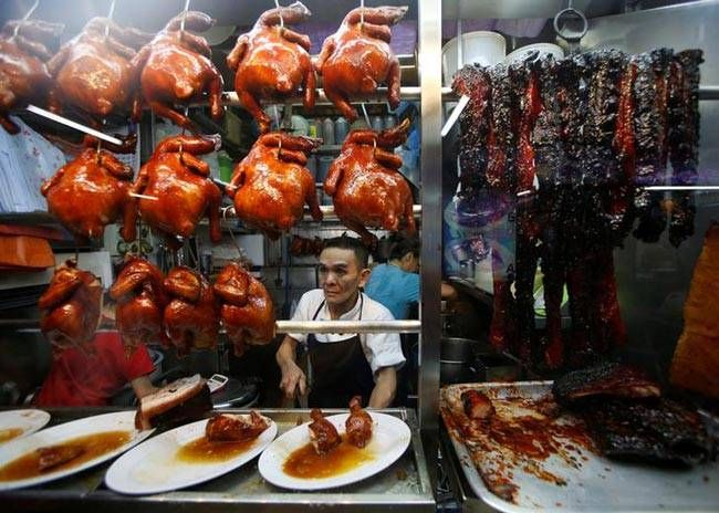 """Hawker Chan Hong Meng, who won a Michelin star, sells soya sauce chicken at his Hong Kong Soya Sauce Chicken Rice and Noodle stall at Chinatown food centre. """"The Michelin star came to me as a surprise, I never expected that hawker food will win such an aw"""