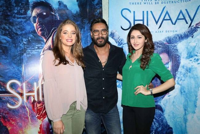 Erika Kaar, Ajay Devgn and Sayyeshaa Saigal at the Shivaay trailer launch.