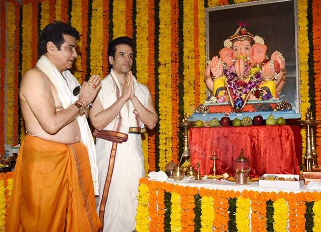 Jeetendra and Tushar Kapoor at their residence