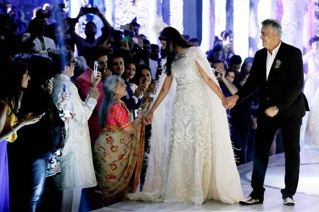 Shweta Bachchan Nanda clasps her mother's hand while walking the ramp.