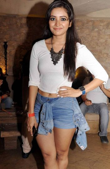 Pavitra Rishta and Bade Achche Lagte Hain actress Asha Negi looked stylish in white crop top and denim hot pants.