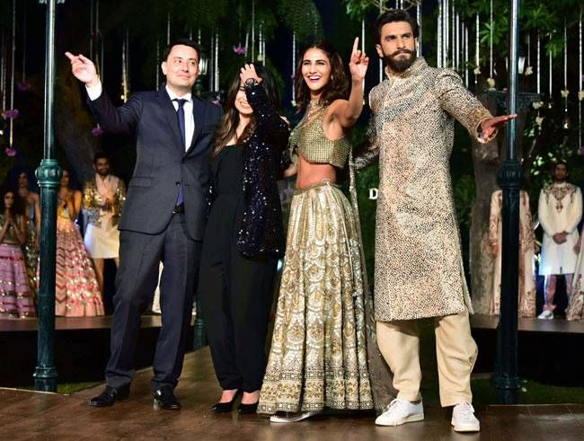 """The actors pose with Alexandre Ziegler, the Ambassador of France to India, and Sanya Dhir, the creative director of DIVA'NI. """"We wanted to bring in the opulence, our love for Paris, the rooted Indian craftsmanship sprinkled with carefree joys of love and"""