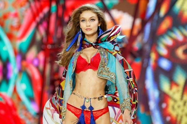 Model Gigi Hadid presents a creation. Eighteen months in the making, the fashion show took two weeks to set up.