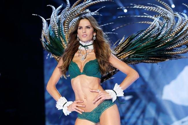 Model Izabel Goulart presents a creation. Many of the creations had beautiful and vibrant feathered wings.