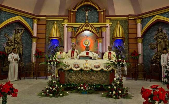 Priests conduct Christmas prayers at a Church in Guwahati