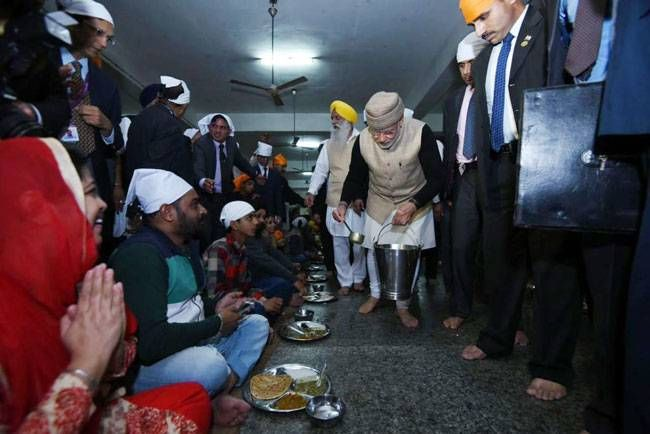 PM Modi serves langar at Golden Temple in Amritsar