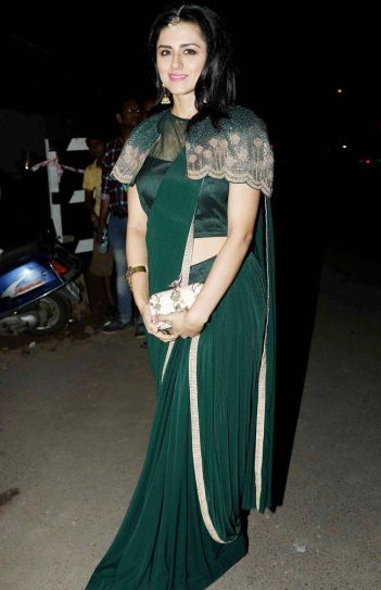Ridhi Dogra makes a statement with her green outfit and pink lipstick.