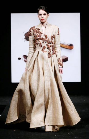 Yes, fashion can be delicious. This model presents delicate chocolate truffles on the bodice of her dress. The truffles look exactly like embellishments.