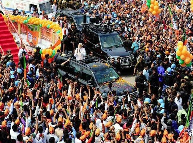 PM Modi greets supporters from car