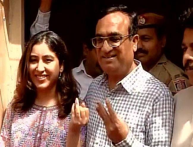 Congress's Ajay Maken casts vote at a polling booth in Rajouri Garden in Delhi.
