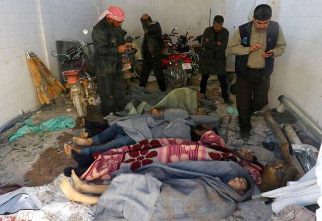 rescue workers help people injured during the gas attack