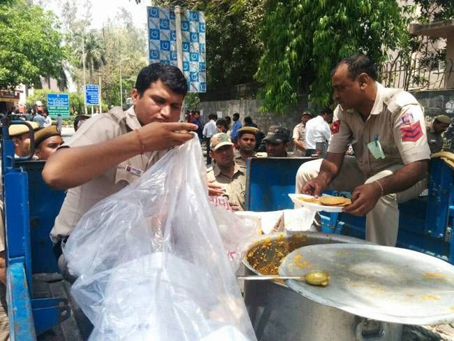 Policemen being served food
