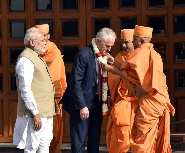 Turnbull and Modi were greeted with garlands at the Akshardham temple. They were then given a tour of the iconic Hindu temple complex.