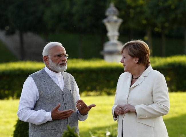 Narendra Modi talks to German Chancellor Angela Merkel during their meeting at the German government guesthouse Meseberg Palace. Modi and Merkel discussed issues of mutual interest in an informal setting over dinner at the 18th-century palace, nearly 80 k