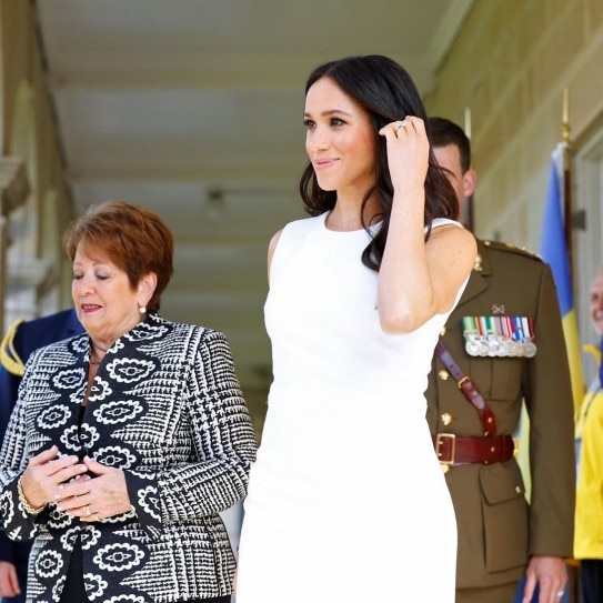 Meghan Markle Glows In White Dress With Prince Harry. See
