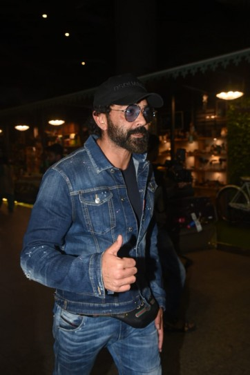Airport Spotting: Bobby Deol returns from holiday with son Dharam and wife Tanya. See pics