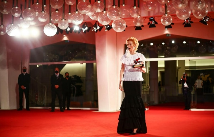 Actress Tilda Swinton poses for photographers with the Golden Lion for Lifetime Achievement at the 77th edition of the Venice Film Festival in Venice, Italy, Wednesday, September 2, 2020
