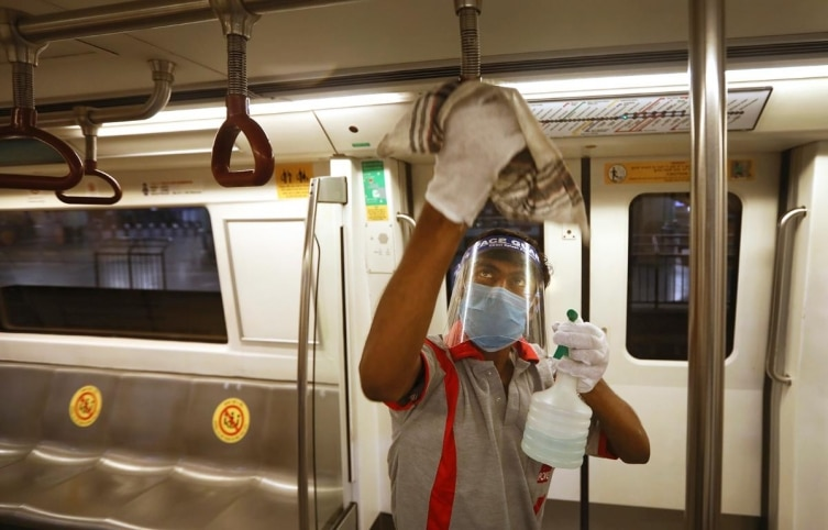 A workers sanitizes a metro coach in New Delhi, India, Thursday, September 3, 2020