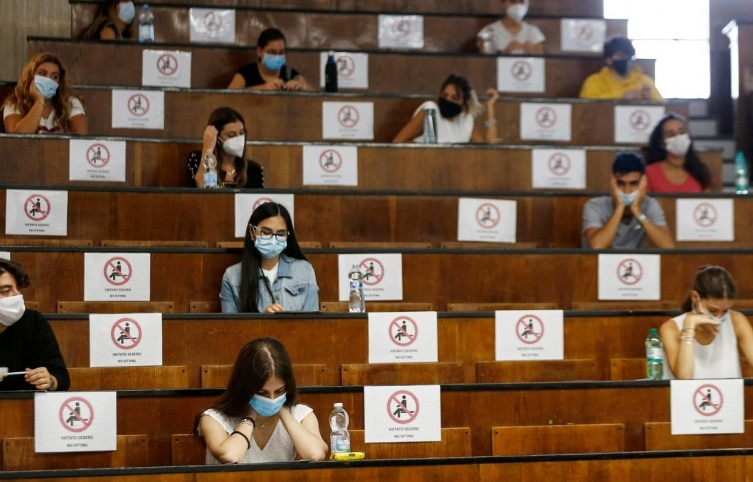 Students sit at a distance as a precaution against COVID-19, as they undergo an aptitude test to access the University of Medicine, in Rome Thursday, September 3, 2020