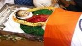 Jayalalithaa's tricolour draped body