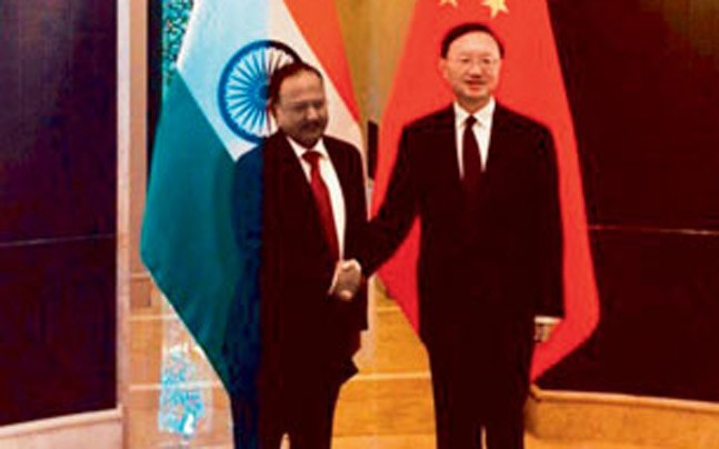 NSA Ajit Doval (left) with Yang Jiechi, newly promoted Politburo member