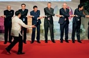The whole world in their hands: At 31st ASEAN Summit, world leaders enjoy a lighter moment