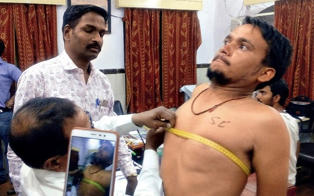 Madhya Pradesh police recruit with caste scratched onto his chest