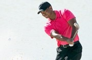 Smiling Tiger Woods ties for ninth as Rickie Fowler wins with 61