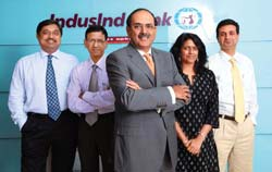 IndusInd Bank's MD & CEO Romesh Sobti (C)