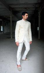 A model wears a creation by Arjun Khanna