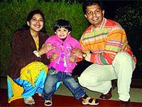Abhishek Bharti (R) and Vanita (with daughter)