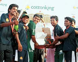 Raigad Royals players lifting the MPL 2009 trophy