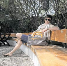 Andy is wearing sunglasses by Yves Saint Laurent at Safilo; Scarf & knit T-shirt by Adolfo Dominguez; Shorts & Bag by Lecoanet Hemant; Leather sandals by Zara