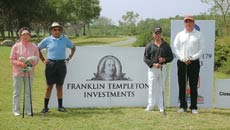 Players pose before teeing off at the associate sponsor Franklin Templeton Investments hole