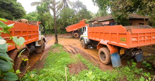 Families living around mines in Goa have invested in tipper trucks with the help of mining companies.