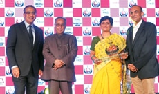 Aroon Purie and Pranab Mukherjee with executives from Suzlon Energy, which won in the Environment category