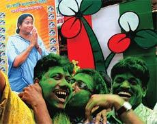 Trinamool supporters celebrate their victory in Kolkata