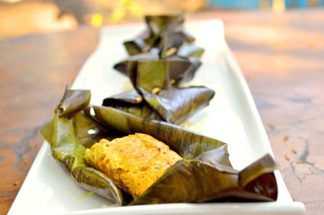 Banana leaves lock in the fiery aromas of the Otak-Otak dumplings