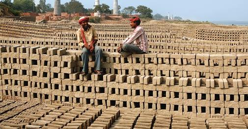 Workers take a break at a brick kiln near Patna