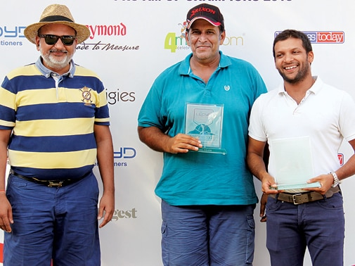 The winning team: Anuj Thapar (middle) of Aspher Foods, who also won the individual 11 to 18 Handicap category, and Mayank Ruia of Phoenix Mills (right) pose with Nipun Singhal
