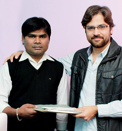 Looking Forward: Pankaj Jangid (right) gifted a pension to Umesh Kumar Singh. Jangid paid the enrolment fee and assured Singh the company would match his monthly contribution to the scheme (Photo: Ria Mukherjee)