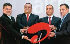 The Airtel brass launch its new logo in Zambia. (From left) Manoj Kohli, Fayaz King of Airtel Zambia, Sunil Mittal and Akhil Gupta