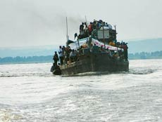 The Kinshasa-Brazaville ferries are fi lled to the brim with people, animals and smuggled produce.