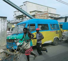 A Tata bus wriggles through chaotic traffic in Kinshasa, DR Congo