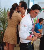 Actor Deepika Padukone hugs Sahara chief Subrata Roy with Shah Rukh Khan in the foreground